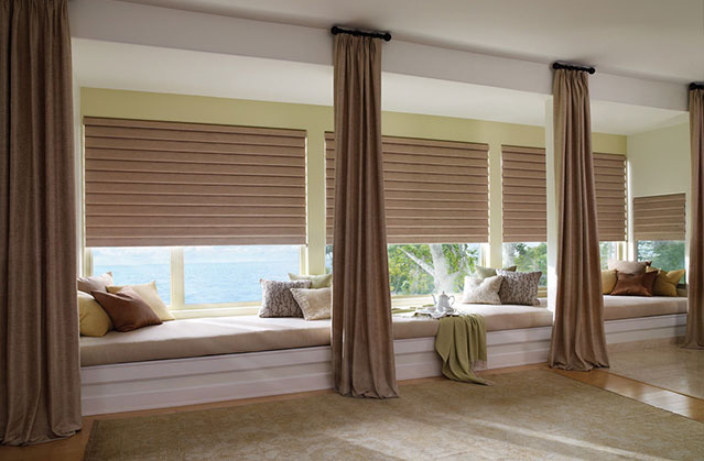 Roman shades and curtains in large bench windows
