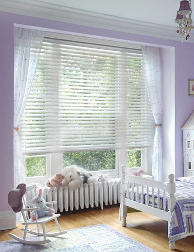 White cordless blinds in a child's room