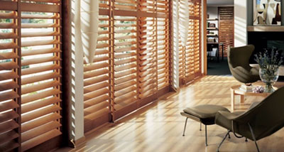 Wood plantation shutters on large living room windows